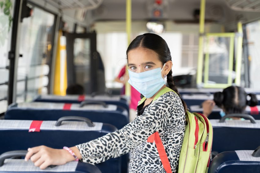 a school girl having safe travel in bus